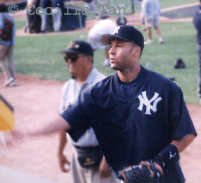 Derek Jeter signs some autographs