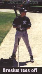 Scott Brosius hits off a tee