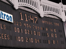 Yankee Stadium scoreboard showing final score at 11:47 pm